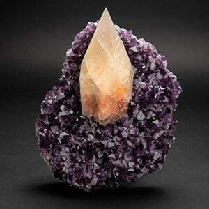 Perfect gem-quality large golden yellow scalenohedral crystal of Calcite centered on a matrix lined with grape purple translucent to transparent top-quality Uruguayan Amethyst. This piece is in supreme condition and is a top collectable specimen.